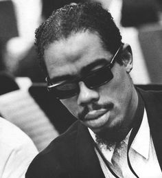 ERIC DOLPHY LOOKING PENSIVE.