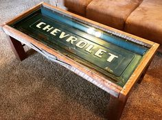 This is the perfect man cave focal point! I encased a vintage rusty clear coated chevy tailgate in my indiana barnwood and used pipe and fittings for