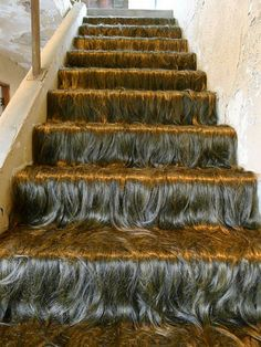 """Behold, Jessica Wohl's """"Hairy Staircase"""" installation: 2011. synthetic hair, fabric and steel installed in the abandoned Mountainaire Hotel, Hot Springs, Arkansas."""