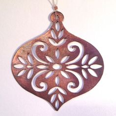 beautiful filigree ornament featuring a Scandinavian motif, hand cut from copper and featuring a brushed finish with a subtle patina.Please note that as this is a hand made item, the colours of the pa Christmas Love, Scandinavian Christmas, Diy Christmas Ornaments, Handmade Christmas, Holiday Crafts, Holiday Fun, Christmas Holidays, Merry Christmas, Christmas 2017