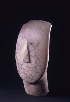 2800-2300 BCE Marble Head and neck of a figurine canonical type, Spedos variety. Cycladic culture flourished in the islands of the Aegean from 3300 - 2000 BCE. Museum of Cycladic Art