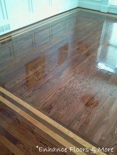 Hardwood floor installation with borders. I like the border but not the high gloss finish.