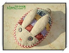 Pincushion Honey Bunny ~ with an Easter egg-like body, would be super easy to make for a Spring gift.