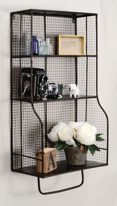 Features: -Rustic, distressed black metal. -Grid metal design. -3 Shelves for ample storage. -Hangs on the wall for space saving storage capabilities. -Easily complements any style décor. -Perfe
