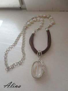 Leather, freshwater pearl, and crystal quartz necklace