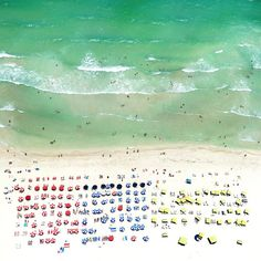 colorful umbrellas by the sea in Miami beach: photo by art photographer Antoine Rose