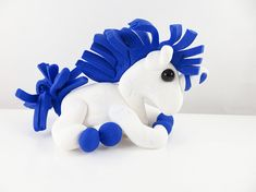 Clay unicorn sculpture figurine with a blue mane and tail Polymer Clay Sculptures, Sculpture Clay, Turtle Earrings, Clay Dragon, Mane N Tail, Making Out, Smurfs, Sculpting, Im Not Perfect