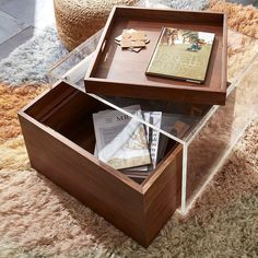 """Shop Studio Acrylic Storage Table.   """"Familiarity reigns, favorites are reimagined with a splash of LA cool and a fashion edge,"""" says Fred Segal of their fresh approach to furniture design."""