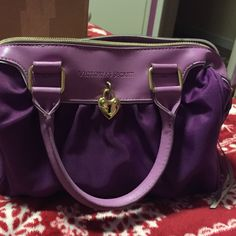 Purple Victoria Secret multipurpose bag  Never used, looks brand new, good for makeup, perfume, lotions and anything else you would like to use it for. Victoria's Secret Bags Mini Bags