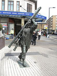 """Sculpture """"The Window Cleaner"""" by Allan Sly outside the tube station."""