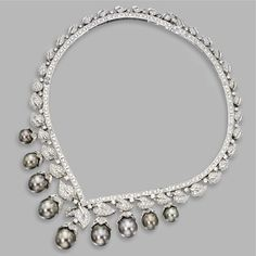 GRAY CULTURED PEARL AND DIAMOND NECKLACE, ITALY The slightly graduated necklace of foliate design set with round diamonds, supporting a fringe of 9 gray cultured pearls measuring 13.8 to 10.3 mm., capped by round diamonds, the total diamond weight approximately 16.70 carats, mounted in 18 karat white gold, length 16 inches, stamped Made in Italy. Estimate 12,000 — 15,000 USD LOT SOLD. 17,500 USD