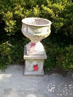 Concrete Urn on Plinth.  Urn has a nice decorative swag. We have 2 in stock.  Our Price $260 per urn