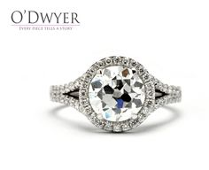 18ct white gold ring with a large center diamond surrounded by sparkling smaller diamonds.