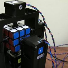 Video: Robot It Can Solve Rubik In 1 Second World's Fastest Rubik's Cube Solving Robot - Now Official Record is 0.900 SecondsProgrammer Jay Flatland and Paul Rose build this incredible m...