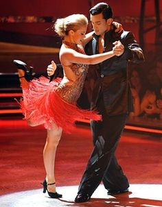 Ballroom dancing caught in motion.