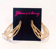 """Fashion fades, only style remains the same. -Coco Chanel """"Im hooked on You Earrings"""" Gold $18.00  Product Description    Gold toned with sparkle look (also available in silver)  To purchase: https://glamandsassy.com/product/im-hooked-on-you-earrings-gold/  Or click link in bio above for the product of the day ✔️Comment with your email and we will send you an invoice!  #ShowYourSparkle ✨ #GlamAndSassy"""