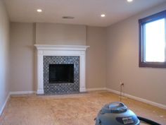 Fireplace Makeover Photos, great idea to cover a floor to ceiling brick fireplace. Good info about how to drywall over brick.