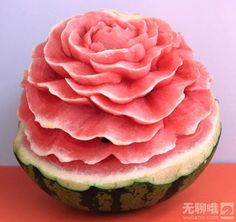 This watermelon rose is way too pretty to eat! [Note: I have tracked this photo back as far as I can; the click-through page is in Japanese, but it has almost three dozen photos (and one video) of GORGEOUS food sculptures. See even more here: http://www.wuliaoo.com/chuang-yi-xi-gua-diao-ke.html]
