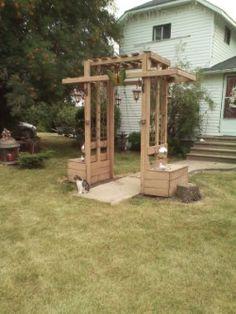meyerlynn arbor with side seating, trellis inserts, solar lanterns