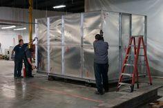 Opening the metal crate of the Komori HUV G40