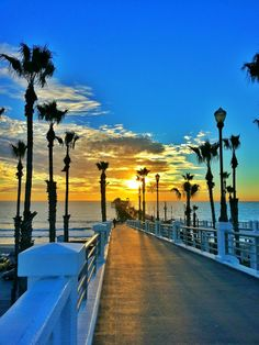 Amazing image shared with us by Robert Lee Woods Jr. on Facebook | Oceanside Pier | sunset | ocean | palm trees Oceanside Pier, Oceanside California, California Vacation, Huntington Beach Surfers, California Pictures, San Diego Vacation, Lighthouses, Orange County, Spring Break