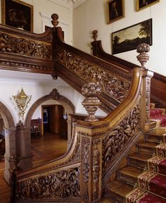 The ornate castles stairway.The Stair Hall oak staircase at Dunster Castle; installed by Colonel Francis Luttrell in the the balustrade carved from elm planks sit between newel posts topped by carved vases. Beautiful Architecture, Beautiful Buildings, Architecture Details, Beautiful Homes, Grand Staircase, Staircase Design, Interior Staircase, Victorian Interiors, Victorian Homes