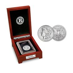 """The First Carson City Morgan Silver Dollar Coin   3 coveted silver dollar coins spanning 3 centuries of America! Handsome display case with mahogany finish, lock with antique-style key, more! Display case measures approximately 8-3/4"""" L x 5-1/2"""" W x 3-3/4"""" H"""