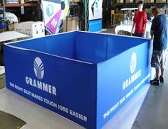 Engage your customers with this unique square hanging display and promote your brand.