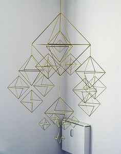 Beautiful mobiles, reminds me of the kind made by crafty kids out of drinking straws