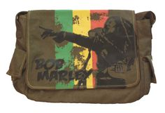 Heavy-duty canvas construction makes this Bob Marley messenger bag a must-have.Features front flap pocket enclosure screen print, contrast stitching, two accessory pockets and Bob Marley logo tag. Rock Shirts, Band Shirts, T Shirts, Hippie Backpack, Rock And Roll History, Rock And Roll Fashion, Rocker, Canvas Messenger Bag, Julie