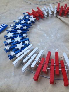 "Using clothes pins, spray paint's Red, White, Blue, wood stars variety of sizes, gorilla glue, 4 layer wire wreath.. So much fun to make as a project with the children for the parents, for 4th of July.. ""Give 3 days to make."" Dry each step including spray painting the wreath white, the clothes pins, then gluing the stars on last after the pins dry for a day. Ribbon. Also doing finger painting the colors and sealing them last. Christmas you can use Christmas colors and ornaments scattered.:"