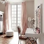 bedrooms - chevron herringbone wood floors French doors blush pink silk drapes glossy white lacquer vanity top polished nickel x base round white tufted ottoman white armoire French oval-back pink velvet tufted chair