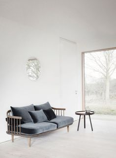 Reydon Grove Farm is a minimal farm located in Suffolk, England, designed by Norm Architects. Grove Farm, Central Hall, Nordic Home, Living Room Furniture, Love Seat, Furniture Design, Lounge, Sofa, Traditional