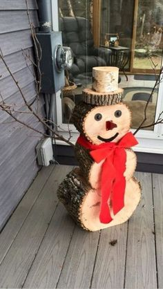 Easy DIY Rustic Christmas Decorations using logs and branches. Perfect farmhouse Christmas or winter decoration for indoors or out doors. Great Budget decor ideas for the home. This Snowman design would be cute at a winter wedding. Wooden Christmas Decorations, Christmas Wood Crafts, Christmas Porch, Rustic Christmas, Christmas Projects, Simple Christmas, Christmas Ornaments, Natural Christmas, Christmas Ideas