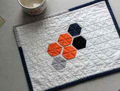 In my Random Perfection quilt I used hexagon applique. Toavoid the problems I encountered where the fabric came out, you will need to make sure some of the folded fabric comesunderneath each sti…