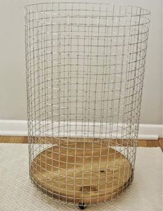 """Cheap & Chic: How To Make a French-Vintage-Inspired Wire Hamper Make a rolling wire laundry basket with a wood round and some hardware cloth. Add a cute canvas liner and you have a chic """"vintage"""" hamper! Wire Laundry Basket, Laundry Hamper, Wire Baskets, Laundry Rooms, Laundry Bin, Plastic Baskets, Diy Storage Containers, Basket Storage, Ball Storage"""