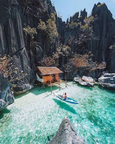 Now how about this waterfront vacation home! Would you live here? We love this little ocean hut perched into the rock formations of Palawan, in the Philippines. Photo by Vacation Places, Dream Vacations, Vacation Spots, Beach Vacations, Beach Travel, Asia Travel, Vacation Trips, Beautiful Places To Travel, Cool Places To Visit