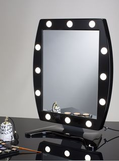 MDW MAKEUP WALL FRAMED MIRROR WITH 12 LIGHTS 470x650. Makeup Vanity Mirrors. Makeup lighted mirror for professional makeup artists and beauty professionals. Wide mirror surface, adjustable light intensity, I-light system Cantoni patented, 110V/240V compatible, low consumption, made in Italy. #makeupmirrors #vanity #lights