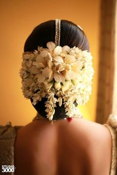 <3 the gajra game this bride has going! with pretty white flowers in the venter and the central mathapatti! stunning #IndianWedding #bridalstyle #hairstyle | Curated by Witty Vows - The ultimate Guide for The Indian Bride | www.wittyvows.com