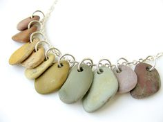 This rainbow necklace is a natural history rainbow of pebbles found and drilled by a fellow handmade artisan. One of a kind (OOAK) Natural Stone Jewelry