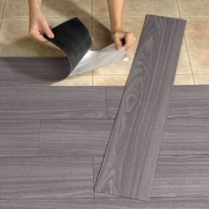 Peel-And-Stick Wood-Look Plank Flooring-- Maybe use it on an accent wall?? :):