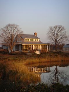 Lake house with wrap-around screened porch. by Peter Zimmerman Architects.