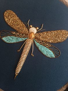 Bedford, England-based embroidery artist Humayrah Bint Altaf (previously) continues to construct ornate insects using shimmering threads and metallic beads. Her dragonflies, bees, beetles, and… New Embroidery Designs, Couture Embroidery, Silk Ribbon Embroidery, Embroidery Hoop Art, Hand Embroidery Patterns, Embroidery Stitches, Embroidery Supplies, Art Patterns, Butterfly Embroidery