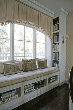 Another beautiful window seat. The sconce is a perfect solution instead of a table and lamp.