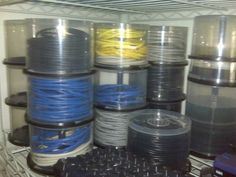 Using old cd spindles for cable storage.  (stick a label on them so you'll know what each is for)