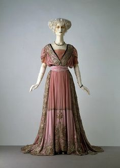 "Evening dress from Jays Ltd, c. 1908. Jay Ltd. Pinner says: The V calls this dress ""transitional"", and it's easy to see why. The skirt is clearly turn-of-the-century, as is the high, poufy bust, but the waist is high and the over all silhouette is straighter than the late Victorian, flirting with the idea of straighter fashions to come."