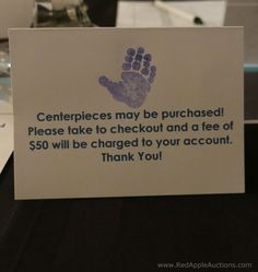 Buy the school auction centerpiece. Please.  (Click thru for advice on selling or giving away.)