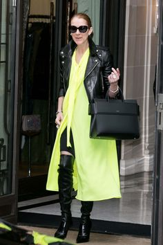 Celine Dion in a Balenciaga dress, Saint Laurent jacket, and Le Silla boots with a Givenchy bag