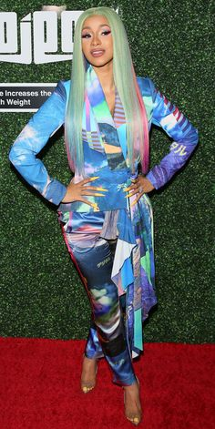 Cardi B's pastel colored pant suit complimented her yellow nails at the Swisher Sweets Awards in West Hollywood.
