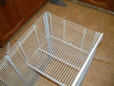 Attachment of second level shelf with cable ties, which were trimmed off with sturdy scissors.  diy rat cage